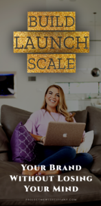 woman entrepreneur smiling at camera while sitting with open laptop on her lap. text in sparkle gold says build, launch, scale your brand without losing your mind